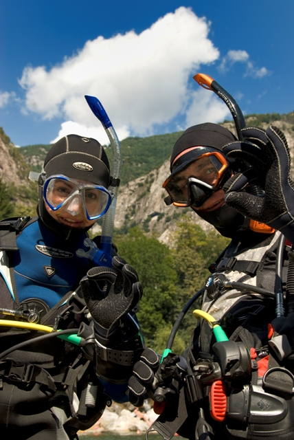 drysuit divers on surface standing